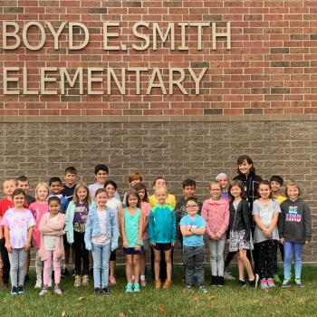 Lisa Holt-Taylor (far right, in back) is pictured here with her third grade class