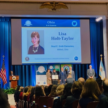 Mrs. Holt-Taylor receives her award on stage in Washington, D.C.